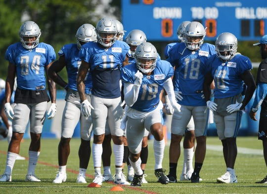 Lions' Kenny Golladay bursts off the line during receiver drills on Monday.