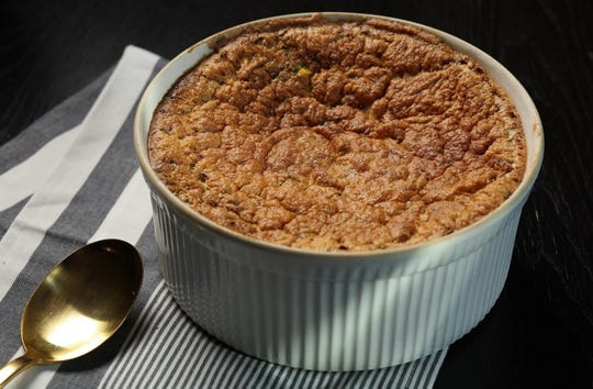 Use up some of that wheelbarrow-load of zucchini in this simple souffle, which is also studded with corn.