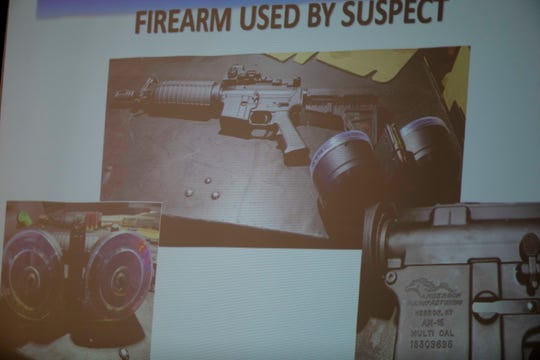 The firearm used by the shooter Connor Betts, 22, is projected on a screen during a press conference Sunday.