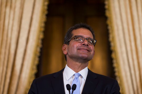 Pedro Pierluisi, sworn in as Puerto Rico's governor, smiles during a press conference in San Juan, Puerto Rico.