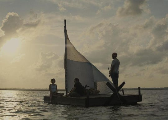 "Dakota Johnson, Zack Gottsagen and Shia LaBeouf in ""The Peanut Butter Falcon."""