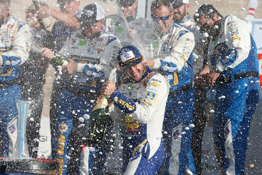Chase Elliott, driver of the #9 NAPA AUTO PARTS Chevrolet, celebrates with crew members in Victory Lane after winning the Monster Energy NASCAR Cup Series Go Bowling at The Glen at Watkins Glen International on August 04, 2019 in Watkins Glen, New York.