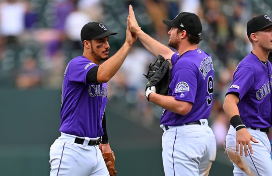 Colorado Rockies third baseman Nolan Arenado, left, and first baseman Daniel Murphy celebrate a win Sunday over the San Francisco Giants at Coors Field in Denver. The Rockies play road games at Houston at 6:10 p.m. Tuesday and 12:10 p.m. Wednesday.