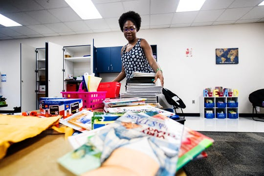 Jessica Jocelin, a first year teacher at James Stephens International Academy in Fort Myers, sets up her classroom on Monday, August, 5, 2019. Monday was the first day back for Lee County School District teachers.