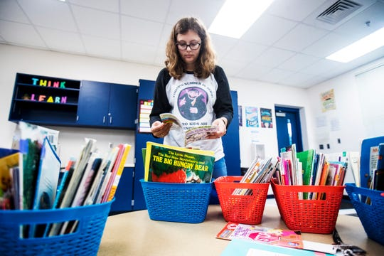 Caitlin Hughes, a second year teacher at James Stephens International Academy in Fort Myers, sets up her classroom on Monday, August, 5, 2019. Monday was the first day back for Lee County School District teachers.