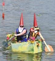 """Brittany Hunt and Arie Hunt paddle their """"Gnome Sweet Gnome'' in the Sturgeon Bay channel during the sea trial part of the Sikaflex Challenge at the 2017 Door County Classic & Wooden Boat Show. The Hunts were overall champions that year."""