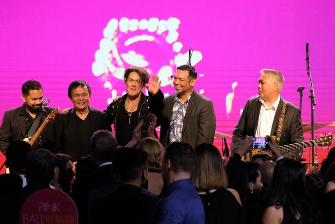 From left, musicians Mike Hartendorp, Dante Trinidad, Mig Ayesa, Rob San Agustin and Eric Tydingco on stage at the Pink Ball held at the Dusit Thani Guam Resort in this Aug. 3, 2019, file photo.