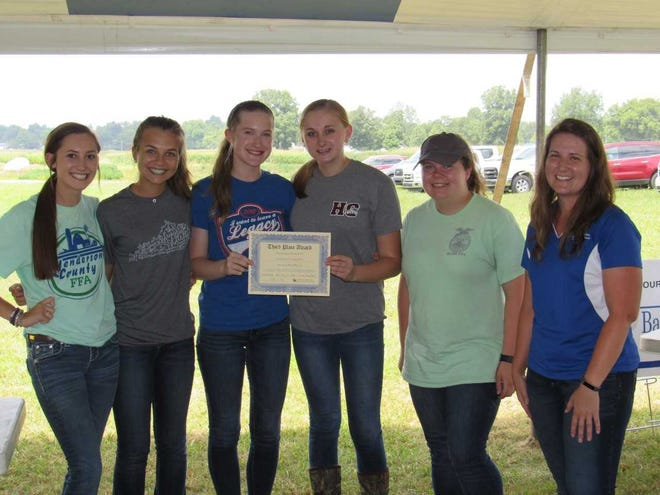 The University of Kentucky High School Crop Scouting Competition was held at the UK Research and Education Center in Princeton, Ky. on July 30, 2019.  First Place honors went to LaRue County FFA; Second Place, Adair County FFA; and Third Place, Henderson County FFA. The event was coordinated by Dr. Kiersten Wise, Extension Plant Pathologist at the UK Research and Education Center in Princeton. She is shown (at right) with the Henderson County FFA.