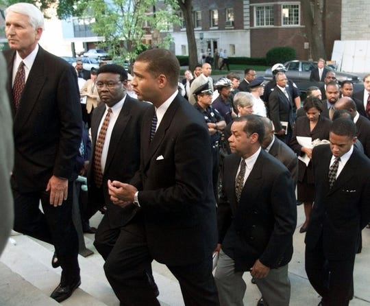 Dignitaries participating in the funeral of former Northwestern Basketball coach Ricky Byrdsong enter First Presbyterian Church   Wednesday, July 7, 1999, in Evanston, Ill. From left, Lute Olsen, University of Arizona basketball coach,  Dr. Isiah McKinnon, former Detroit chief of police, Scott Perry, former assistant coach at Northwestern, Perry Watson, basketball coach at University of Detroit Mercy, and B.J. Armstrong former Chicago Bulls player.  Byrdsong was murdered in an apparent hate crime shooting spree last week. (AP Photo/Michael S. Green)