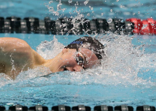 Carmel's Jake Mitchell competes in the 500 freestyle setting a new record of 4:16.72  at the IHSAA boys swimming and diving state finals at IUPUI Natatorium, Feb. 23, 2019.