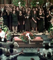 A choir sung before the casket of former Northwestern University basketball coach Ricky Byrdsong on July7, 1999, at First Presbyterian Church in Evanston, Ill.