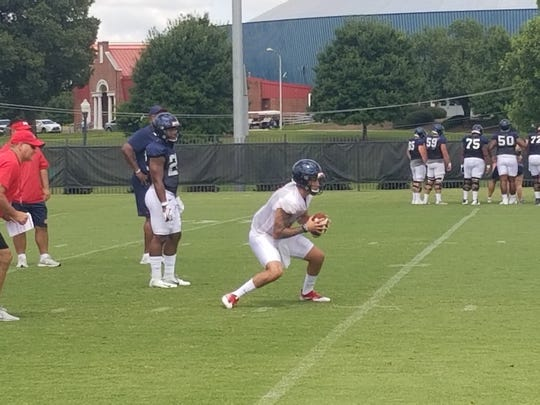 Ole Miss quarterback Matt Corral carries out a fake in practice on Aug. 5, 2019