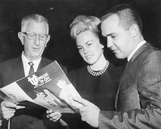 In a Feb. 18, 1967, photograph, University of Tennessee President Andy Holt, left, strikes a pose for a News-Sentinel photographer with Mr. & Mrs. William B. Stokely III at Stokely Athletics Center. The Stokely family was honored before the Tennessee-Vanderbilt basketball game for its $600,000 gift to the university that made the athletic center possible. The photo caption noted that Mrs. Stokely, the former Kay Haslett, Knoxville, is a former U-T beauty. (KNS Archive)