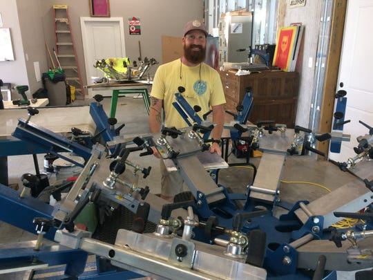 Mark Gilleran's shop is crowded but has large doors to let the outside in.
