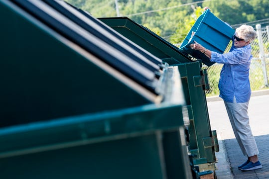 Paper items are dropped off to be recycled at the Carter Convenience Center on Monday, Aug. 5, 2019.