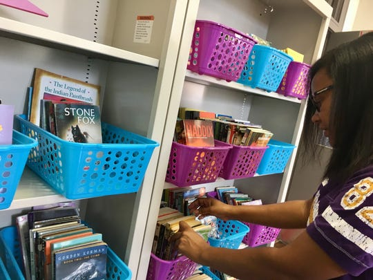 Fourth-grade teacher Tiffany Castille has prepares a reading corner in her classroom in Dr. Raphael A. Baranco Elementary School, one of two new elementary schools opening in Lafayette Parish this school year. The site previously was N.P. Moss Preparatory Academy.