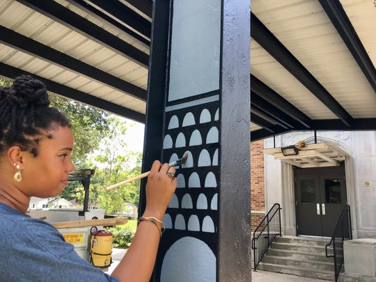 Art teacher Corinne Johnson has been adding details to Dr. Raphael A. Baranco Elementary School, one of two new elementary schools opening in Lafayette Parish this school year. The site previously was N.P. Moss Preparatory Academy.