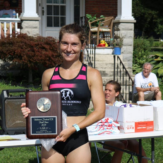 Lancaster's Sammie Zishka defended her women's title in the 28th annual Baltimore Festival 5K run with a time of 17:32.