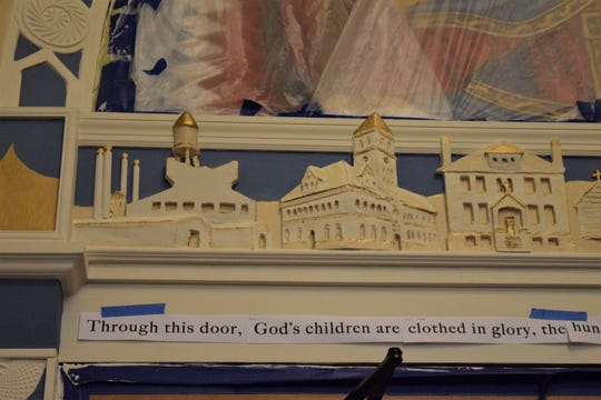 The new lintel across the entrance to St. Mary of the Assumption Catholic Church's sanctuary. Artist Andrew Smith wanted to connect Lancaster with the church for its bicentennial.