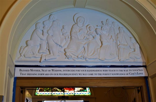 The relief of the Madonna surrounded by a family and the Dominican Sisters waits for its final touches in the sanctuary of St. Mary of the Assumption Catholic Church. The piece is an addition to celebrate the church's history for its bicentennial this year.