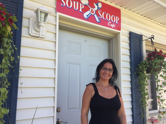 Susie Ansara stands outside her new Mediterranean cuisine inspired restaurant Soup & Scoop Café, Friday, Aug. 2, 2019. The eatery, café and ice cream parlor is set to open this Friday in Green Oak Township.