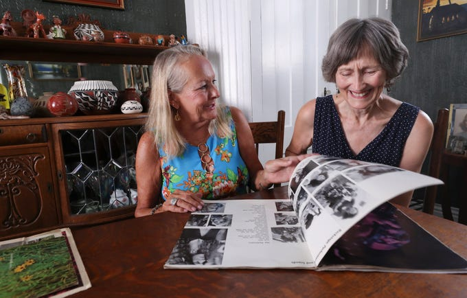 Karen Knight-Wilburn, left, and Nancy Brown flip through the pages of a magazine featuring the Woodstock concerts they attended in 1969.  They were  both 19-years-old and attending UK at the time.Aug. 5, 2019