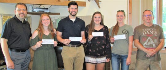 Manitowoc County Fish and Game Protective Association awarded five $1,000 scholarships this year. Four were given to undergrad students and one was given to a grad student. Pictured from left: Dan Dufek, president of Manitowoc County Fish and Game, Sydney Herman, Tanner Harding, Bailey Page, Jade Arneson and Dan Becker, Fish and Game vice president. Missing from photo is Samantha Schuettee.