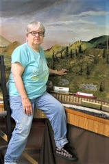 Artist Judy La Grow spent her summer climbing the railroad tracks updating the scenery at Clipper City Model Railroad Club at Manitowoc County Expo grounds.