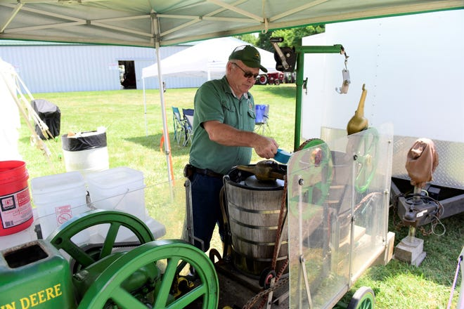 Carl Rader, of Tiro, adds sugar to his homemade ice cream Monday at the Richland County Fair.