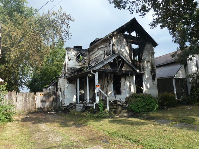 The house at 552 Pearl Street was destroyed in an early morning inferno Sunday that also damaged the two neighboring houses.
