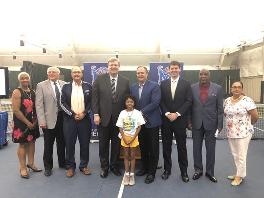 Mayor Jim Strickland poses with members of the Memphis athletics department and Tennis Memphis after announcing a $19 million expansion project of Leftwich Tennis Center.