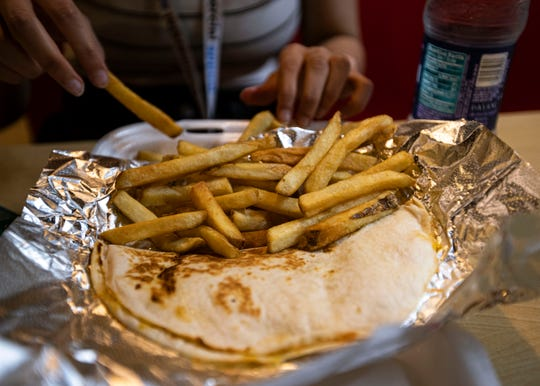 A Cook Out tray with two cheese quesadillas and a side of fries.