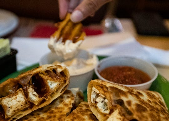 RP Tracks, the college bar, located by the train tracks menu features BBQ tofu quesadilla, with a side of waffle fries and Cajun mayo.