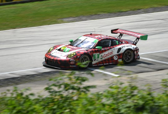 The GTD-class Porsche of Matt Campbell and Zacharie Robichon drives off Turn 12.