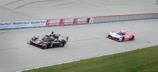 Harry Tincknell in the No. 55 Mazda holds off Dane Cameron in the No. 6 Acura on the run to the checkered flag Sunday in the IMSA Road Race Showcase at Road America.