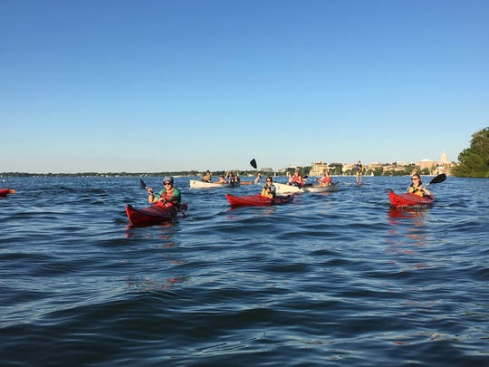 The Glow Float is a popular sunset paddle on Lake Mendota with the Natural Resources Foundation's Wayfarers group.