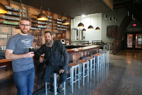 Joe Yeado (left) founder, and Corey Blodgett, brewmaster celebrate two years of Gathering Place Brewing with a party on Aug. 17.