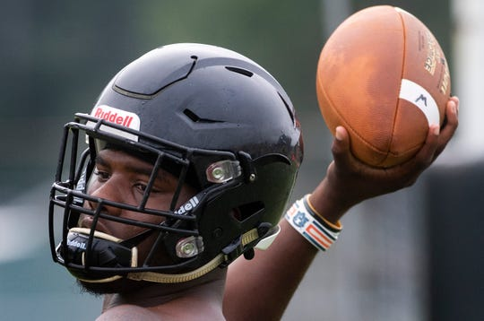 Quarterback Tyquan Rawls passes as Wetumpka High School football practice is held in Wetumpka, Ala., on Monday August 5, 2019.