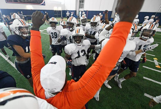 Auburn defensive players celebrate after a contract drill during practice on Sunday, Aug. 3, 2019 in Auburn, Ala.