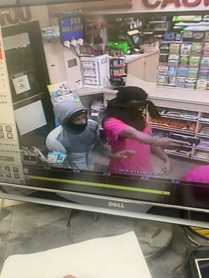 Muncie police have released photos, from a surveillance video, that show two men who robbed a clerk at the Village Pantry, 101 E. Memorial Drive, shortly after 4 a.m. Monday.