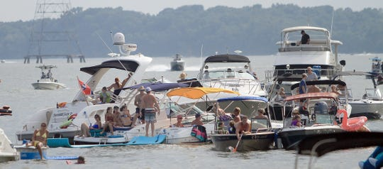 Folks attend The Fire On the Water Music Festival via boat in Galllatin, TN on Saturday, August 3, 2019.