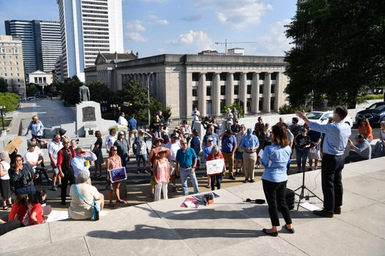 Concerned citizens hold a rally at the state capitol to end gun violence Monday, Aug. 5, 2019, in Nashville, Tenn.
