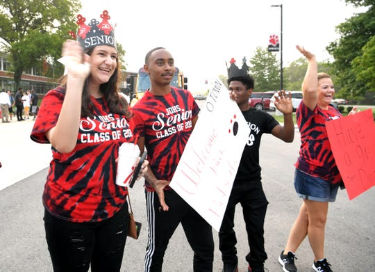 Overton High School seniors Yaya Ali, left, and other students and staff welcome back studewnts on the first day of school on Monday, August 5, 2019.