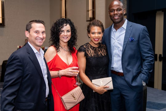 Brian and Robin Murray and Kayla and Deo Sanders attend the 40th Anniversary l'Eté du Vin at the JW Marriott.