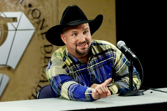 Garth Brooks entered his first full year of retirement in 2001, having walked away from the stage in October 2000. Here, Brooks answers a question during a news conference announcing his plans Oct. 26, 2000.