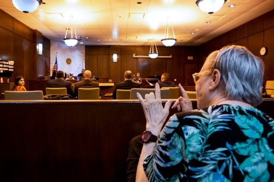 Susan Priser, right, gestures to her daughter Rocquel Priser that she loves her during Rocquel's competency hearing at the Collier County Courthouse in Naples on Thursday, July 11, 2019. Rocquel Priser, 39, faces a second-degree murder charge in connection with the killing of Rocky Priser.