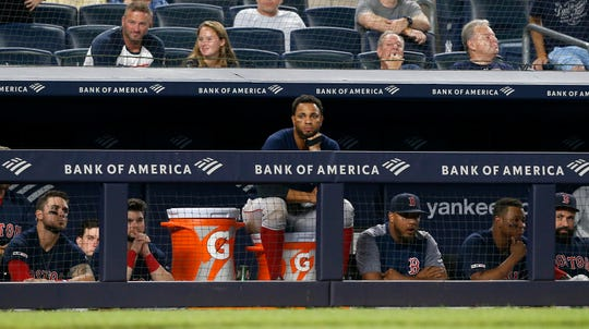 Xander Bogaerts #2 of the Boston Red Sox looks on from the dugout during the ninth inning against the New York Yankees with his teammates at Yankee Stadium on August 04, 2019 in New York City.