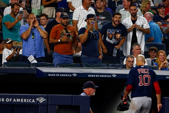 Fans yell at Boston Red Sox pitcher David Price (10) as heads for the dugout during the third inning of a baseball game against the New York Yankees on Sunday, Aug. 4, 2019, in New York.