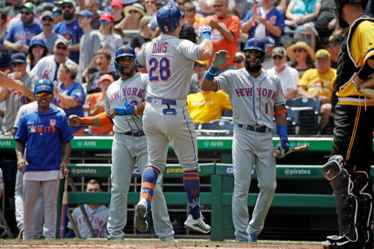 New York Mets' J.D. Davis (28) celebrates as he heads to the dugout after hitting a two-run home run off Pittsburgh Pirates starting pitcher Joe Musgrove during the first inning of a baseball game in Pittsburgh, Sunday, Aug. 4, 2019.