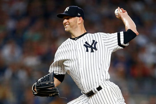 New York Yankees pitcher J.A. Happ delivers during the first inning of a baseball game against the Boston Red Sox, Sunday, Aug. 4, 2019, in New York.